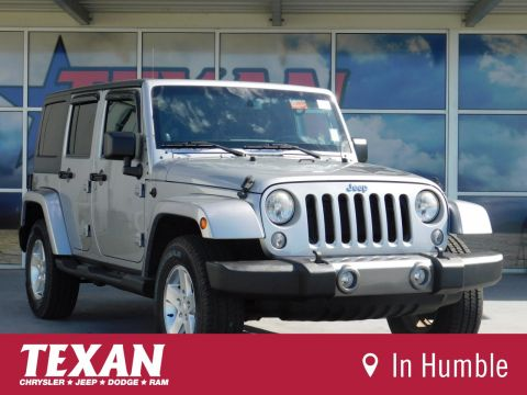 Pre-Owned 2014 Jeep Wrangler Unlimited Freedom Edition